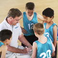 image of coach with players